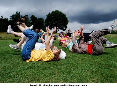 people lying on their backs with their feet in the air doing laughter yoga